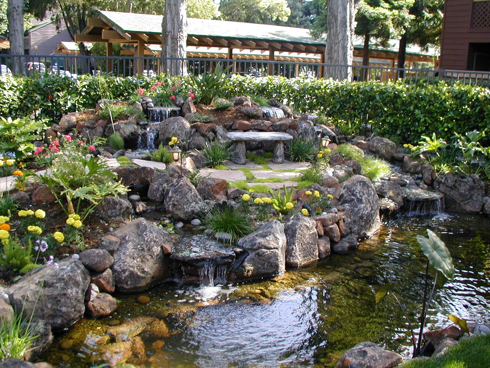 Backyard water feature designs backyard design ideas for Garden designs with water features