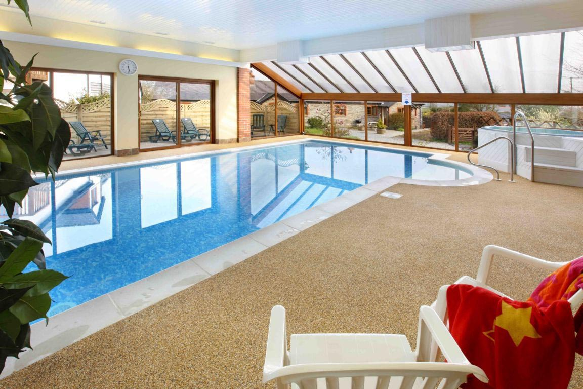 Heated indoor swimming pool backyard design ideas for Pool design show
