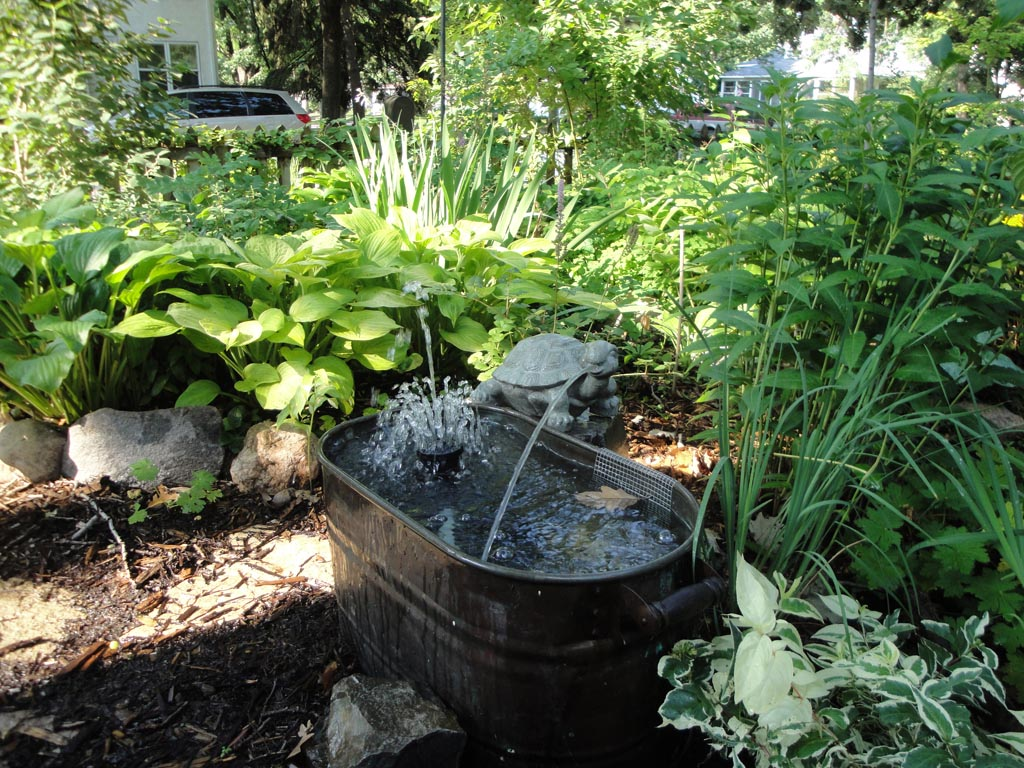 Backyard landscaping with water fountains backyard for Backyard water feature plans