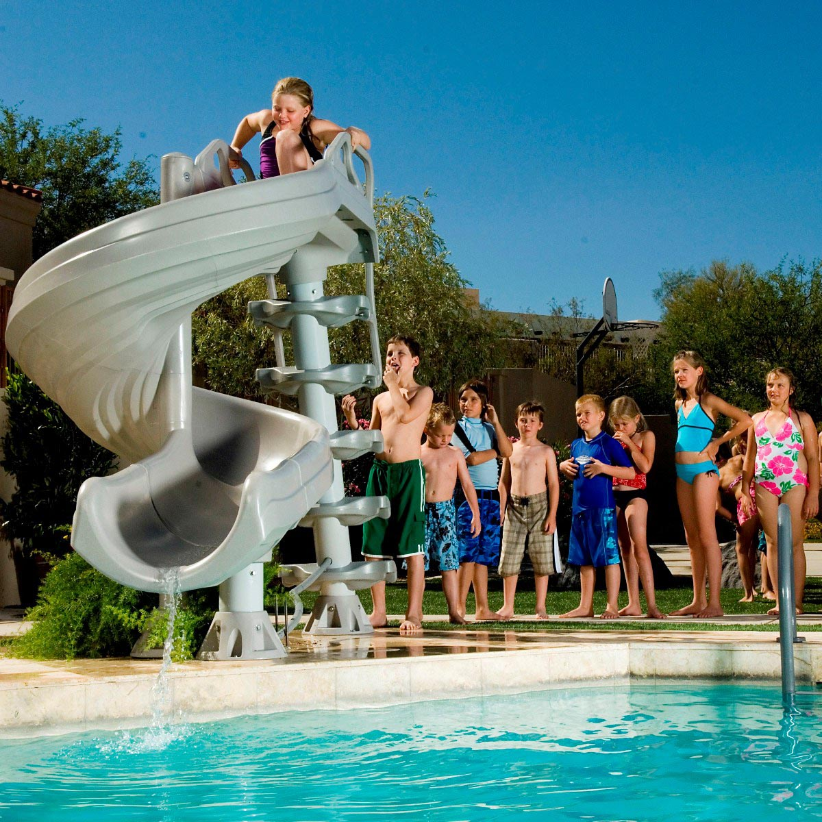 Backyard pool water slide backyard design ideas for Pool design with slide