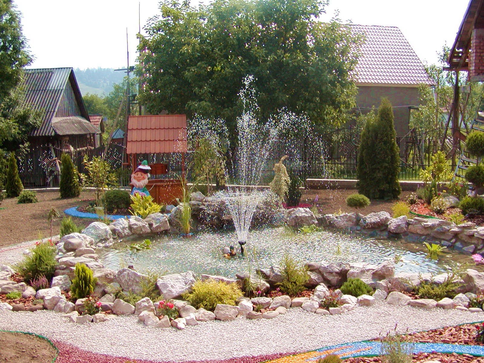 Landscape design with water fountains backyard design ideas for Water landscape design