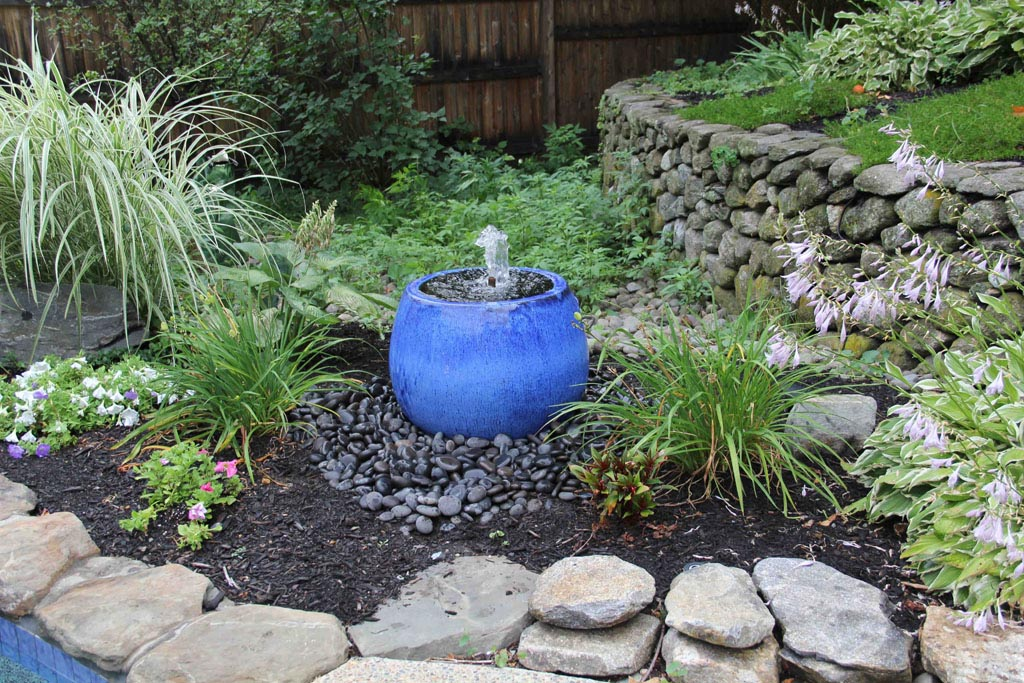 Landscaping around water fountains backyard design ideas for Garden designs with water features