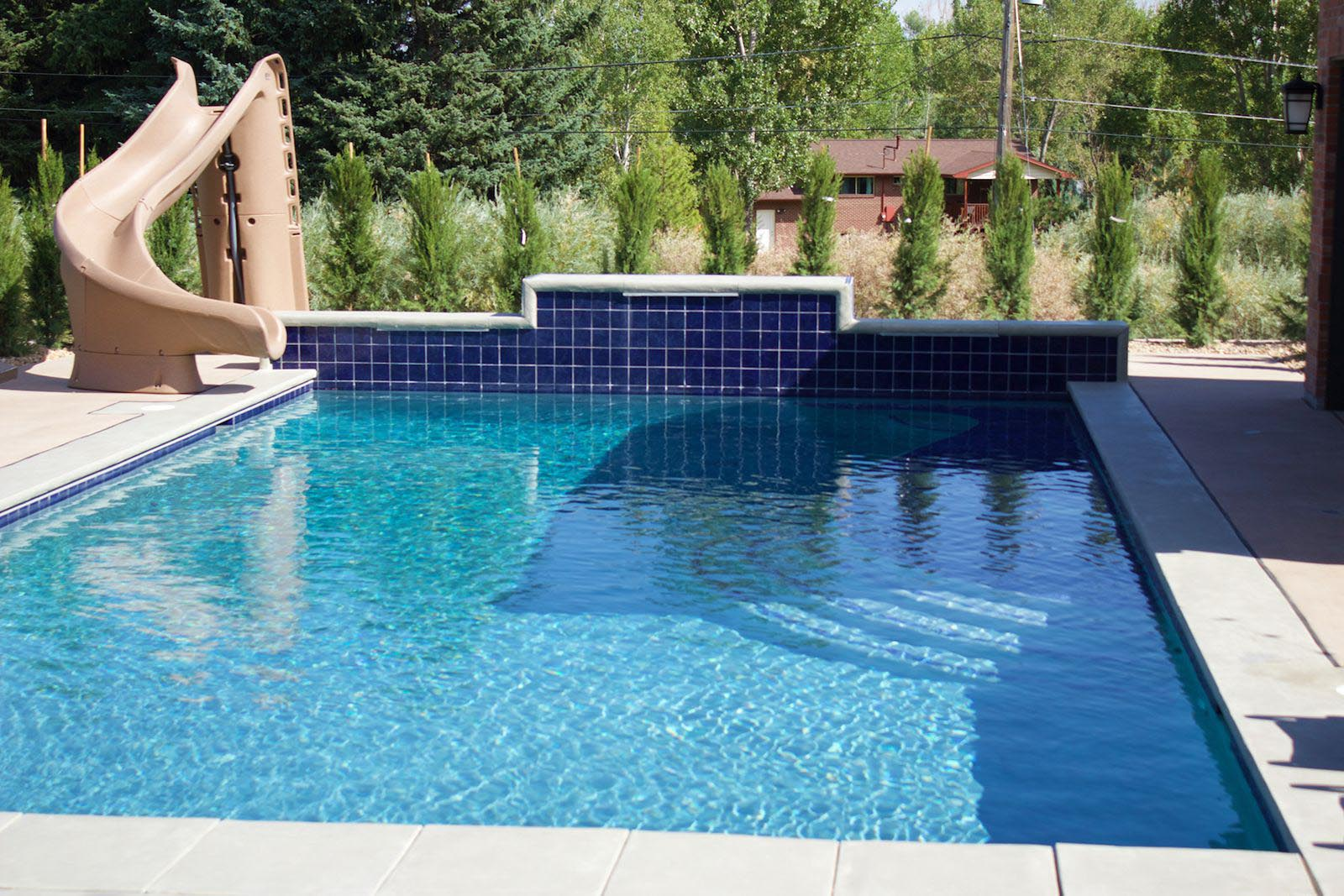 Slide for backyard pool backyard design ideas for Swimming pool ideas for backyard