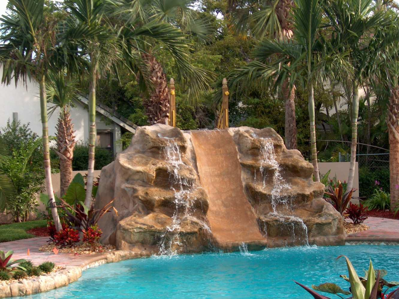 Artificial rock waterfalls for pools backyard design ideas for Pool design with slide