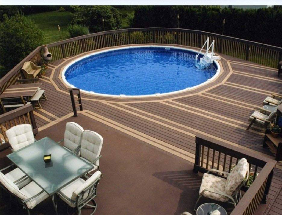 Decks around above ground swimming pools backyard design for Above ground pool decks for small yards