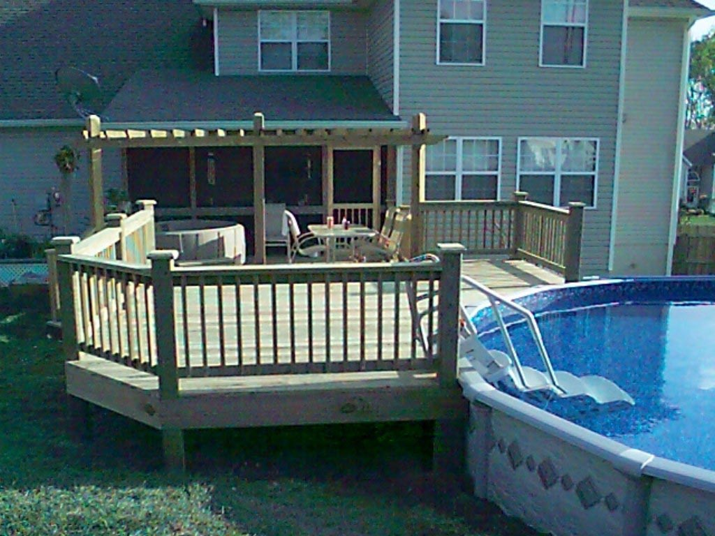 Decks for above ground swimming pools backyard design ideas for Above ground pool decks photos