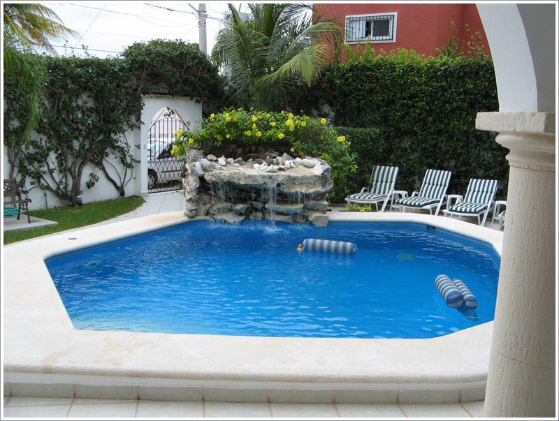 Fountains for swimming pools backyard design ideas for Outdoor pool decorating ideas
