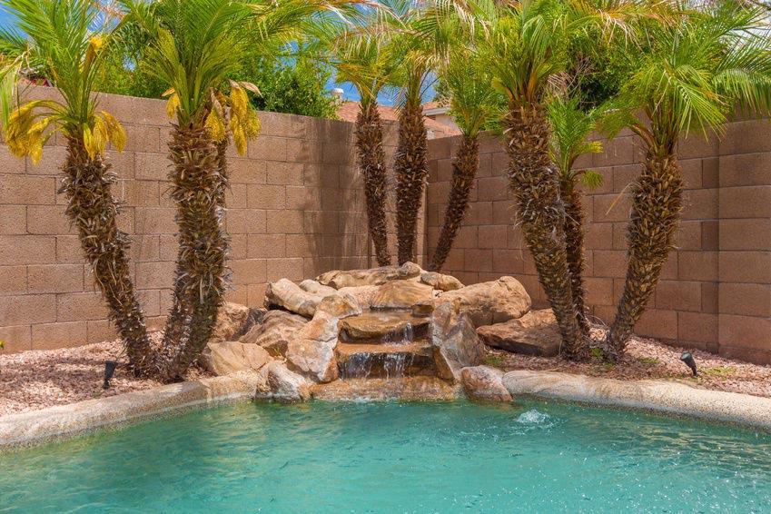 Pool rock waterfall kits backyard design ideas for Swimming pool waterfalls construction