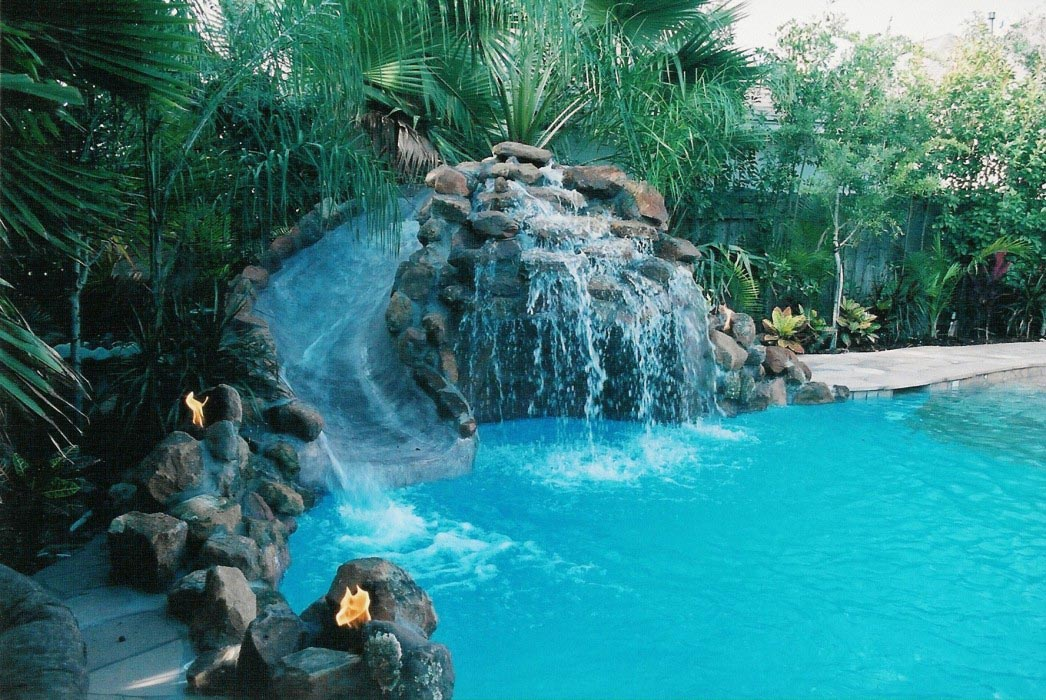 Pools with waterfalls and slides backyard design ideas for Pool design with slide