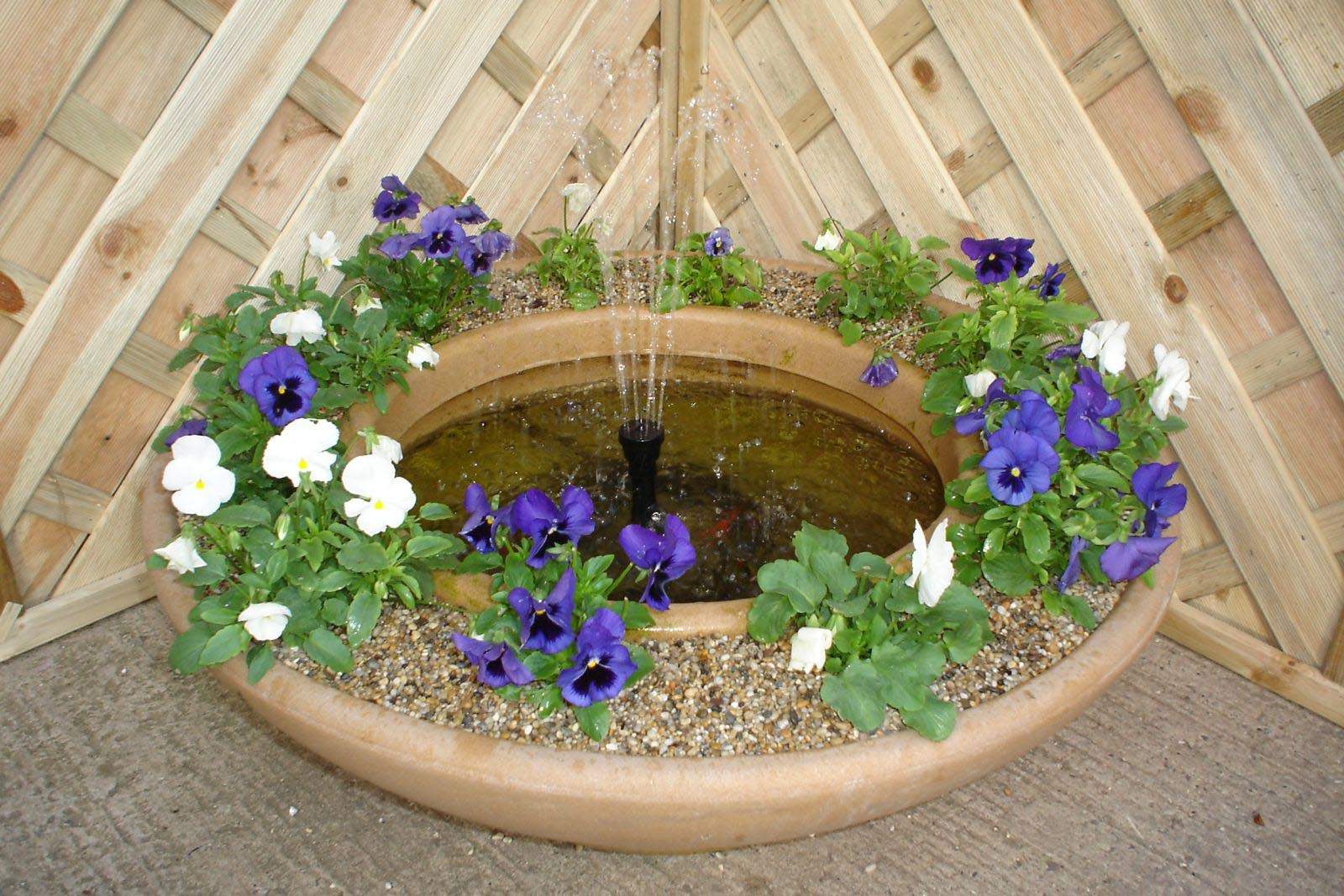 Small garden pond fountains backyard design ideas for Small pond fountains