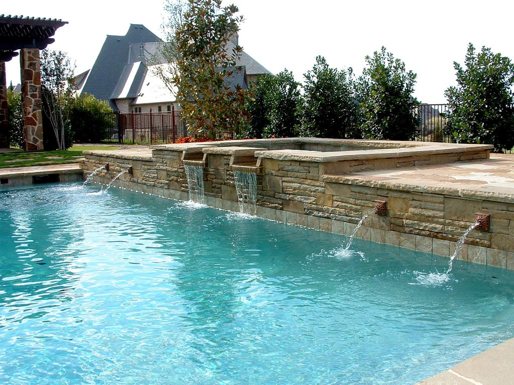 Swimming pool water fountains backyard design ideas for Garden pool fountains