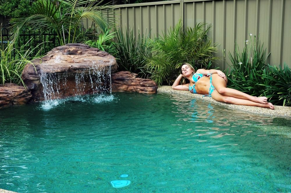 Swimming pool waterfall kit backyard design ideas for Swimming pools with waterfalls